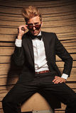 Elegant blond business man taking off his sunglasses. Royalty Free Stock Photo