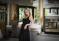 Elegant blond girl at the restaurant stock photography