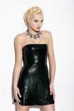Elegant Blond Woman in Black Leather Dress Royalty Free Stock Photo