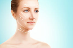 Elegant blond woman portrait with surgery marks on blue Royalty Free Stock Photography