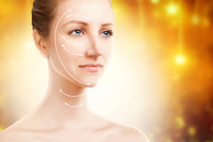 Elegant blond woman portrait with surgery marks on golden backgr Royalty Free Stock Photo