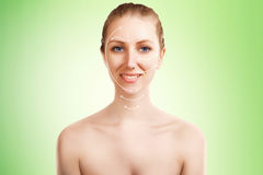Elegant blond woman portrait with surgery marks on green Royalty Free Stock Photo