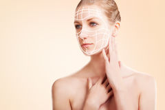 Elegant blond woman portrait with surgery marks on pink Royalty Free Stock Images