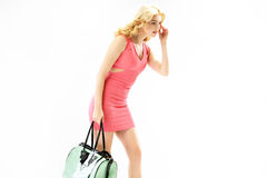 Elegant blond woman with a trendy handbag Royalty Free Stock Photos