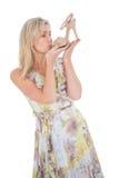 Elegant blonde admiring a shoe Royalty Free Stock Photo