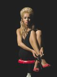 Elegant blonde on black background Stock Image