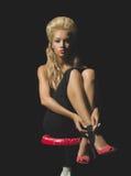 Elegant blonde on black background Stock Image
