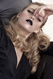 Elegant blonde with black lipstick Royalty Free Stock Image