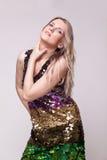 Elegant blonde in bright dress Stock Photo