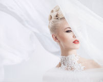 Elegant blonde with a bright veil on the head Royalty Free Stock Photography