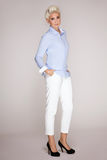 Elegant blonde businesswoman posing. Stock Images