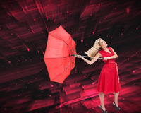Elegant blonde holding umbrella Stock Photography