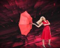 Elegant blonde holding umbrella Stock Photography