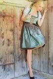 Elegant blonde model in a dirndl stock photography