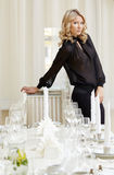 Elegant blonde posing in posh restaurant Royalty Free Stock Photos
