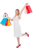 Elegant blonde with shopping bags and gifts Stock Image