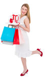 Elegant blonde with shopping bags and gifts Stock Photography