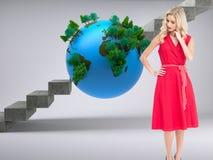 Elegant blonde standing hand on hip Stock Photo