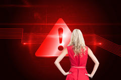 Elegant blonde standing hands on hips Stock Photography