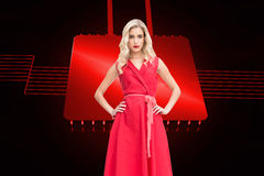 Elegant blonde standing hands on hips Royalty Free Stock Photos