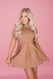 Elegant blonde woman in a miniskirt Stock Photo