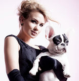Elegant blonde woman posing with pug dog. Royalty Free Stock Photo