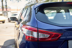 Elegant blue car headlight outdoors Stock Photography