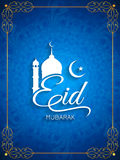 Elegant blue color Eid mubarak card design. Stock Photography