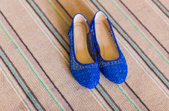 Elegant blue flat shoes for women. In stones Royalty Free Stock Photography