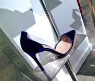 Elegant blue suede stiletto. Gianvito Rossi blue suede point-toe pump women shoes displayed at Saks Fifth Avenue store in Toronto Stock Images