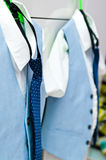 Elegant blue suits and shirts for two boys royalty free stock photo