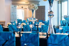 Elegant blue-themed wedding table setup with floral decorations