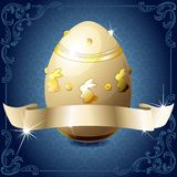 Elegant blue and white banner with chocolate egg. High gloss design with a gold banner wrapped around a decorated chocolate egg. Graphics are grouped and in Stock Photos