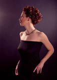 Elegant  bosomy mature woman in black tight dress Royalty Free Stock Photo