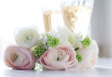 Elegant bouquet of flowers and two glasses of wine Royalty Free Stock Photo