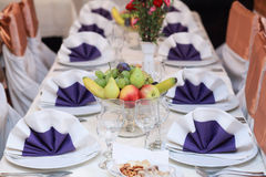 Elegant bowl of fruit on the table. Elegant table set in classic style dining room interior Royalty Free Stock Image