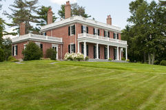 Elegant brick mansion Stock Images