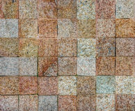 Elegant brick wall from small square stone Royalty Free Stock Photo