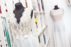 Elegant bridal clothing in workshop Stock Image
