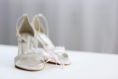 Elegant bridal shoes and a garter Royalty Free Stock Image