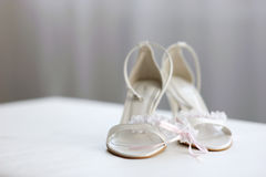 Elegant bridal shoes and a garter Stock Photography