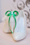 Elegant bridal shoes and a white garter Stock Image