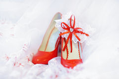 Elegant bridal shoes and a white garter Royalty Free Stock Photo