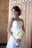 Elegant Bride. Vertical image of a elegant bride posing in a doorway royalty free stock image