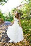 Elegant bride in autumn sunny nature Stock Image