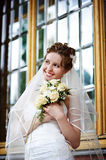 Elegant bride on background of palace windows Royalty Free Stock Images