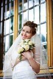 Elegant bride on background of palace windows royalty free stock images