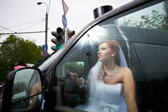 Elegant bride into big car Royalty Free Stock Photos