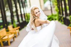 Elegant bride dancing and posing Stock Photos