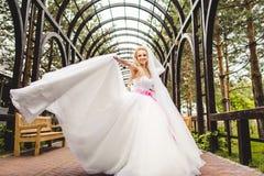 Elegant bride dancing and posing Royalty Free Stock Photography